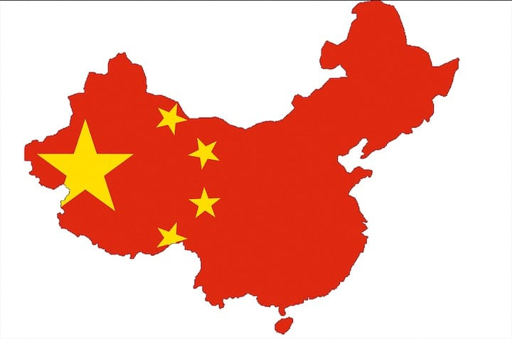 Flag of Communist China over Political Outline of Cina (Credit: Pixabay)