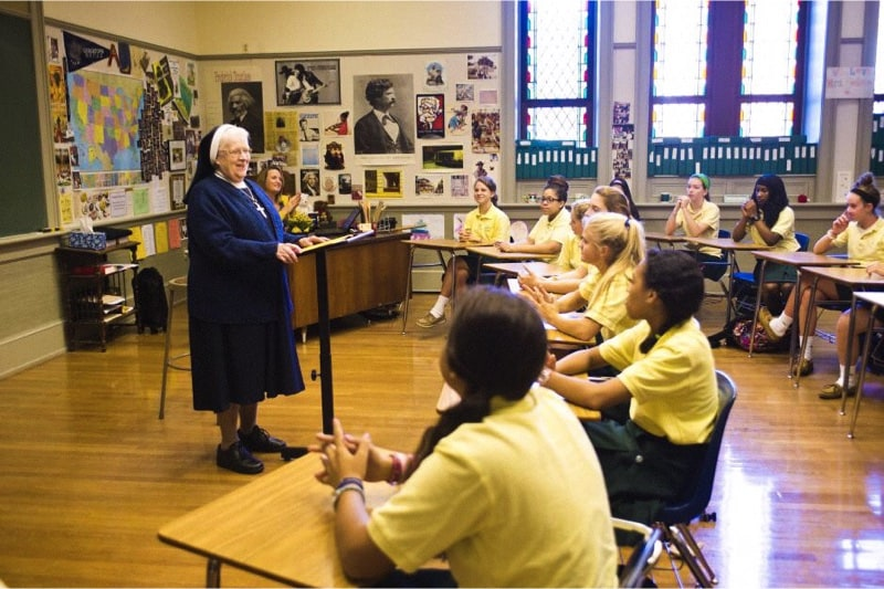 Sr. Mary Berchmans Hannan leads her homeroom in prayer. (Georgetown Visitation Preparatory School)